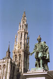 CHURCH AND STATUE ON THE MARKET IN ANTWERP Royalty Free Stock Photo