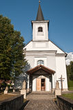 Church with statues in Oravsky Biely Potok. Village in Orava region in Slovakia royalty free stock photography