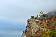 Church on the steep slope of the fall in the mountains. Landscape Stock Photography