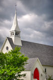 Church Steeple. Tall Church with a Vibrant Red Door stock photography