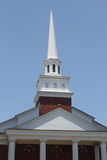 The Church Steeple. A church steeple rises in a clear blue sky Stock Photo