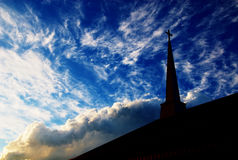 Church Steeple against a cloudy sky 02. A church steeple in a cloudy sky at sunset Royalty Free Stock Photography