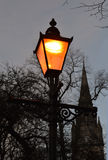 Church steeple behind old-fashioned street lamp Stock Photo