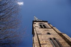 Church Steeple and Blue Sky. A church steeple darting into a clear blue sky Royalty Free Stock Photos