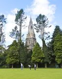 A Church Steeple and Bowling Green, Ambleside. Ambleside, England - July 27: St. Mary's Church steeple on July 27, 2012, in Ambleside, England. Lawn bowlers stock image