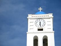 Church Steeple and Clock. The steeple of a church, with the big clock royalty free stock images