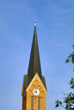 Church Steeple with a Clock and a Cross Royalty Free Stock Photo