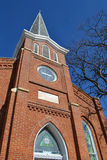 Church steeple and facade. The front facade and steeple of a smalltown church in central Illinois Stock Photo