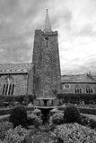 Church Steeple and Fountain B&W. A church steeple and gardens against a stormy sky Royalty Free Stock Images