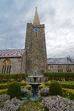 Church Steeple and Fountain. A church steeple and gardens against a stormy sky Royalty Free Stock Photos