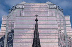Church steeple in front of stylish modern office building Royalty Free Stock Photo