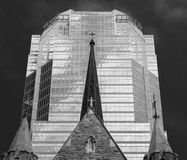 Church steeple in front of stylish modern office building Stock Images