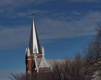 Church Steeple. Metal church steeple against a blue sky in winter Stock Image