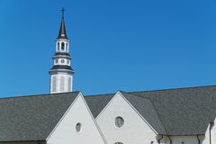 Church steeple and roofline Stock Photo