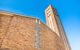 Church steeple under blue sky Stock Image