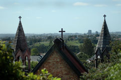 Church Steeples. Roof line of church against urban background Stock Photo