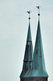 Church Steeples. Tin roofs cap two church steeples of a church in Nuremberg, Germany Stock Photo