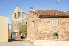 The church and a stone made house in Casillas de Atienza, province of Guadalajara, Spain. The church and a stone made house in Casillas de Atienza, province of royalty free stock images