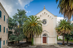 Church and stone old house calm view with palms Royalty Free Stock Photo