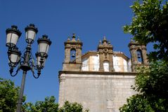 Church and street light framed by trees and sky-Grazalema El Bosque-Benaojan Andalusia (Spain) Stock Photos