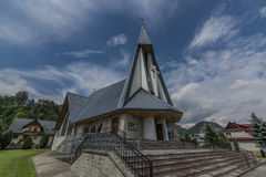 Church in Stromowce Nizne village with blue sky Royalty Free Stock Images