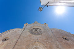 Church, sun and blue sky in Italy Stock Image