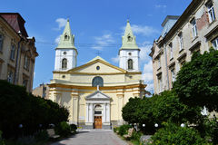 Church in a sunny day. Little church and avenue in fine weather Lviv Ukraine Royalty Free Stock Images
