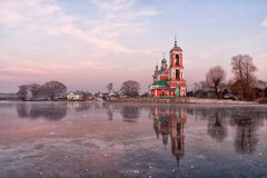 Church at sunset. Against the first ice Royalty Free Stock Photography