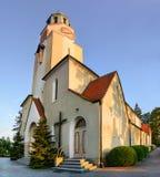 Church at sunset in the city Dobzhen Wielki, Polska Stock Photo