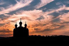 Church at sunset concept of Christianity. Silhouette of Christian church against colorful sunset sky Royalty Free Stock Images
