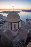 Church at sunset over  Caldera, Santorini, Greece Stock Photos