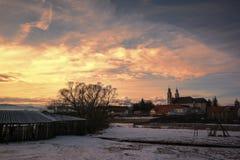 Church in sunset. Winter landscape, Csíksomlyó -Sumuleu, Miercurea Ciuc / Csikszereda, Harghita County, Romania stock image