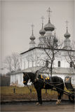 The church of Suzdal. Small church with black horse near it in russian town Suzdal in Vladimir Oblast. It forms part of the Golden Ring stock photography