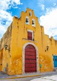 Church of the sweet name of Jesus in the city of Campeche, Mexico. Yellow colonial church with a deep blue sky named the sweet name of Jesus in the city of stock photography