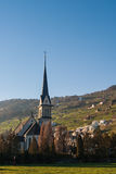 Church in the Swiss Alps. View over a church on a village at the Swiss Alps stock photography