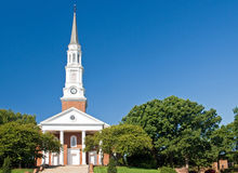 Church with tall steeple. A view of the tall steeple and front entrance to the campus church at the University of Maryland Royalty Free Stock Photo
