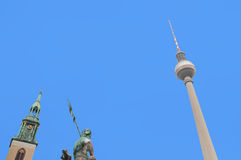 Church, television tower and fountain at the city Berlin, Germany Stock Photo
