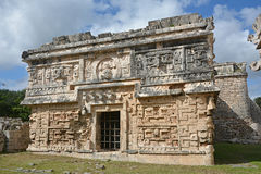 Church and temple of reliefs in Chichen Itza. Royalty Free Stock Photo