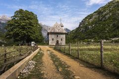 Church in Theth mountain village, Albania. Dusty earth path to the wonderful and unique church in Theth mountain village, Albania, Europe Royalty Free Stock Photo