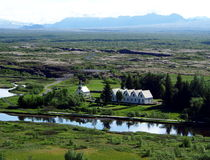 Church in Thingvellir National Park - Iceland. Chapel, cemetery and row of houses located close to the lake at Þingvellir / Thingvellir National Park Iceland Stock Images
