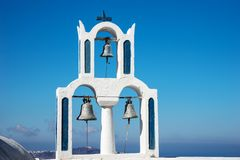 Church with three bells in the town of Fira Santorini Royalty Free Stock Photos