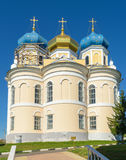 Church with three blue and golden domes against cloudless sky Royalty Free Stock Image
