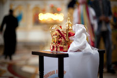 Church tiara on the table. During blessing Stock Image