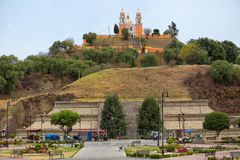 Church on top of buried pyramid in Cholula Mexico. March 31, 2014 Cholula, Mexico: the most popular tourist attraction of the city is the Great Pyramid with the Royalty Free Stock Image