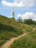 The church on the top of the hill and the small path to it. Stock Image