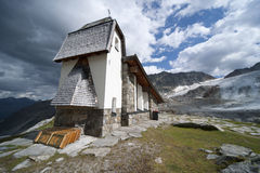 Church on top of mountain in Austria Stock Photo