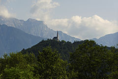 Church on the top of the mountain on the background of the alps Stock Photo