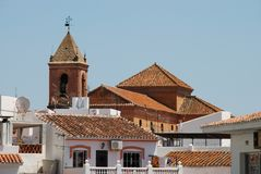 Church, Torrox, Andalusia, Spain. Townhouses with church to the rear, Torrox, Costa del Sol, Malaga Province, Andalusia, Spain, Western Europe Stock Images