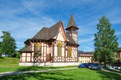 A church and tourists in Stary Smokovec, Slovakia. Royalty Free Stock Photography