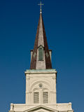 Church tower. A church tower isolated on a blue sky Stock Images